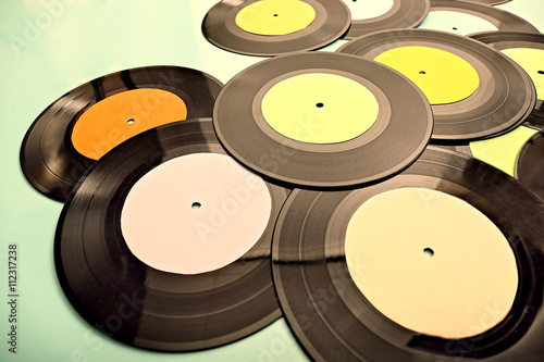 Photo  Vinyl records on coloured background