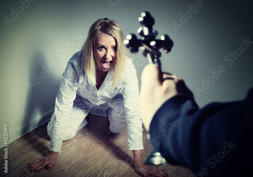 Obraz na płótnie Casting out a demon from a woman through prayer.