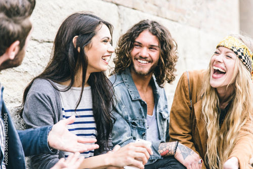 Obraz na plátně Group of four friends laughing out loud outdoor, sharing good mood