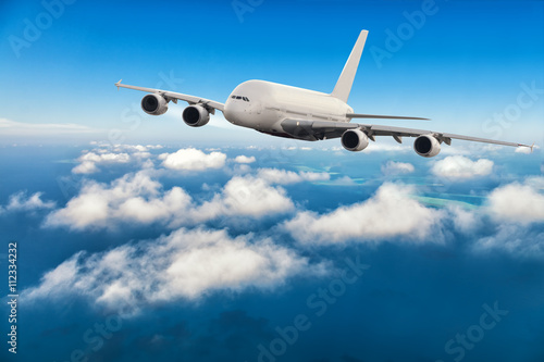 Plakat  Commercial jet plane flying above clouds