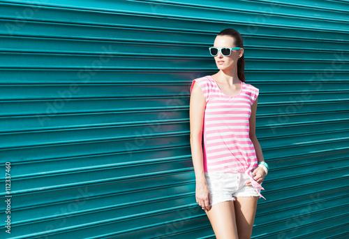 Fotografie, Obraz  High fashion female model against a green background.