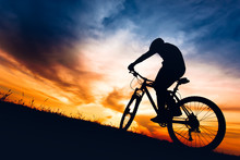 Silhouette Of Biker Boy Riding...