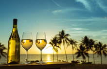 Relaxation And Holiday Concept. Glass Of Wine And A Beautiful Sunset View.