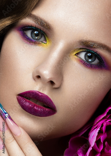 Beautiful girl with colorful make-up, flowers. beauty face. Poster
