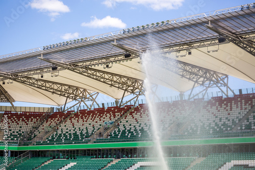 Poster Stadion Watering grass on big sport stadium