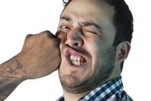 Man Face Receiving A Punch