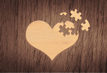 Wooden Puzzle Heart On Grey Wooden Background