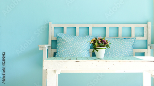 Foto op Plexiglas Retro Blue vintage living room, white wooden bench and table on blue wall