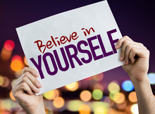 Believe In Yourself Placard With Night Lights On Background