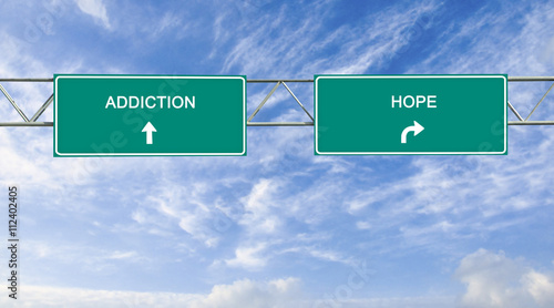 Photo Road sign to addiction and hope