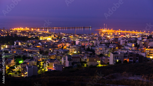 City on the water Rethymno cityscape with a harbor at twilight, island of Crete, Greece