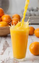 Orange Juice Pouring Splash