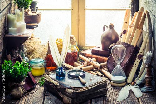Fotografie, Obraz  Unique witch workshop full of scrolls and recipe