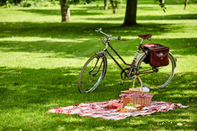 Bicycle And Picnic Spread In A Lush Green Park