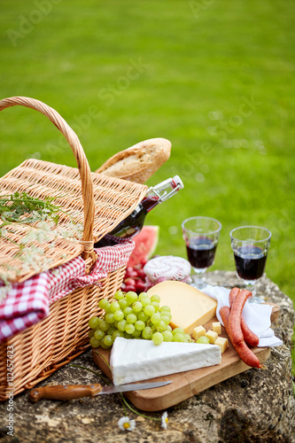 Aluminium Prints Picnic Stylish picnic with red wine, fruit and cheese