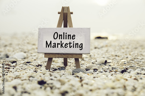 Vászonkép conceptual image with word ONLINE MARKETING on white canvas frame with wooden tripod stand