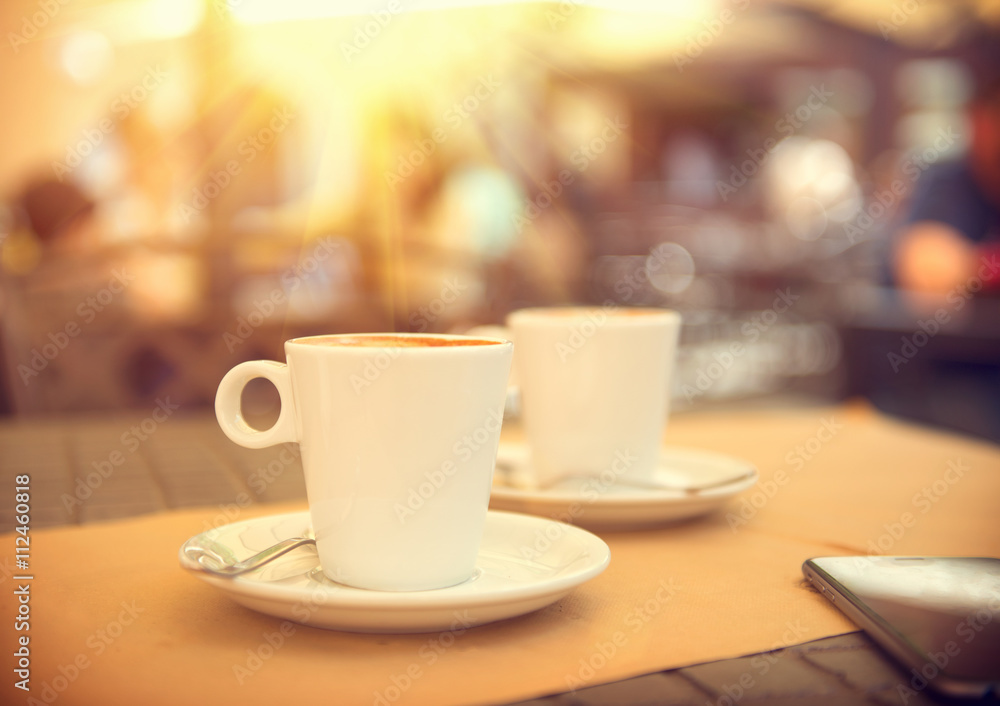 Morning coffee on the terrace in cafe. Cup of espresso