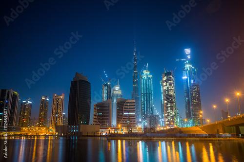 Tuinposter Dubai UAE Dubai night city skyline from Business Bay
