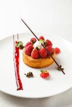 Sable Breton Or Breton Shortbread With Vanilla Cream And Raspberry Coulis On White Dish