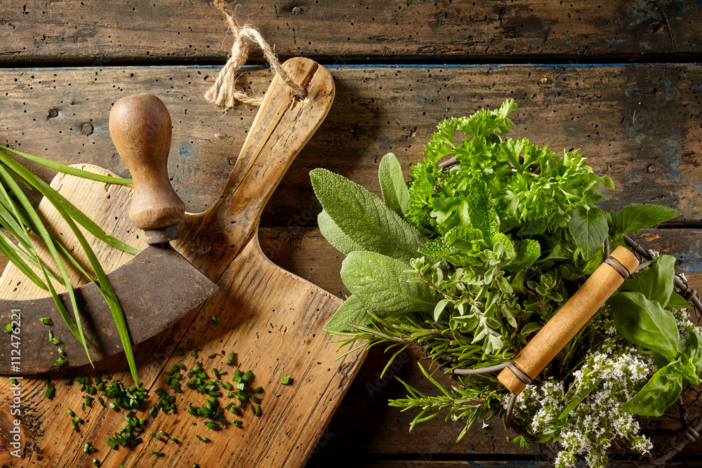 Fototapety, obrazy: Various herbs in preparation on cutting board