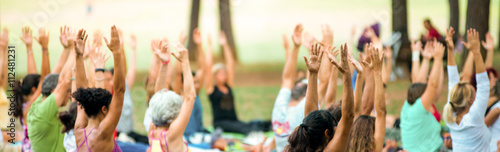 Keuken foto achterwand School de yoga banner of hands up of people doing yoga