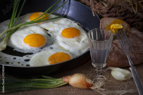 Foto op Plexiglas Gebakken Eieren Eggs fried in a pan