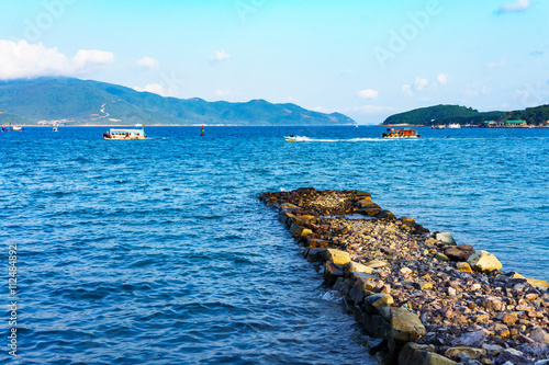 fototapeta na lodówkę old stone Pier and blue sea