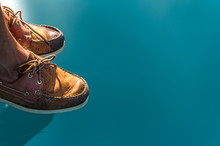 Sailing Shoes Reflecting On Crystal Clear Seawater