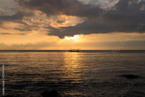 Photo  Sunset and ocean view on paradise beach Negara - Bali Island, In
