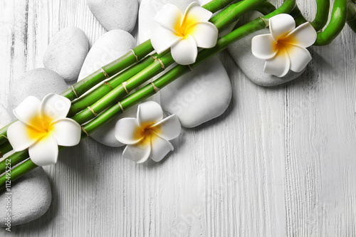 Photo  Beautiful spa composition with bamboo on light wooden background