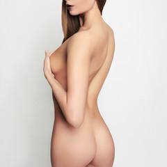 Fototapetanaked body girl covers her breast