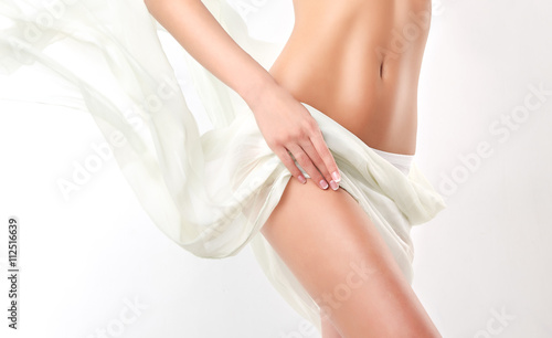 Slim tanned woman   Perfect Body Canvas Print