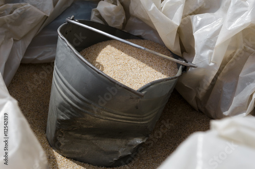 Photo  Construction bucket of fine sand for repair.