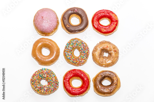 Colorful glazed donuts collection isolated on white background, top view Canvas Print