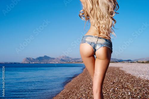 Fotografie, Obraz  Beautiful slender blonde at the sea