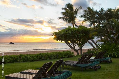 Tela  Sunbed chairs on beach near the sea