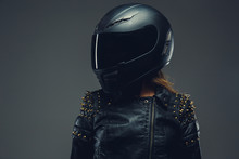 Female In Motorcycle Helmet And Leather Clothes.