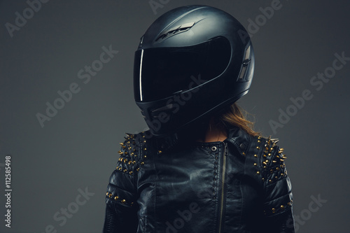 Female in motorcycle helmet and leather clothes. Wallpaper Mural