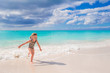 Adorable little girl have fun at shallow water during summer vacation