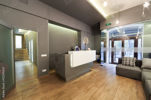 Lobby entrance with reception desk in a dental clinic. Fototapeta