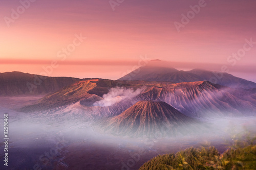 Fotobehang Indonesië Mount Bromo twilight sky sunrise time with fog nature landscape