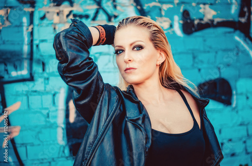 0eead29ce beautiful young blond woman in a black body in leather jacket ...