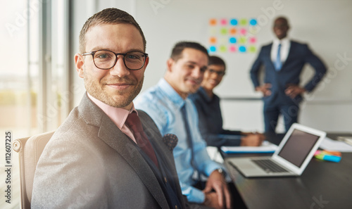 Fototapety, obrazy: Handsome man with three co-workers in meeting