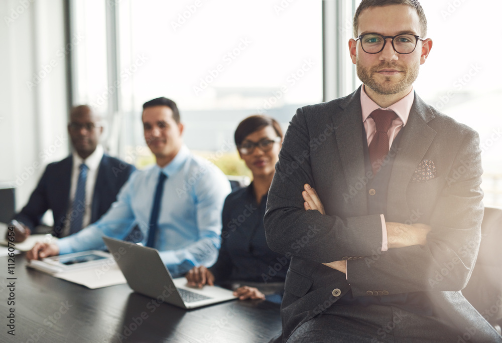 Fototapeta Handsome bearded professional sitting on desk