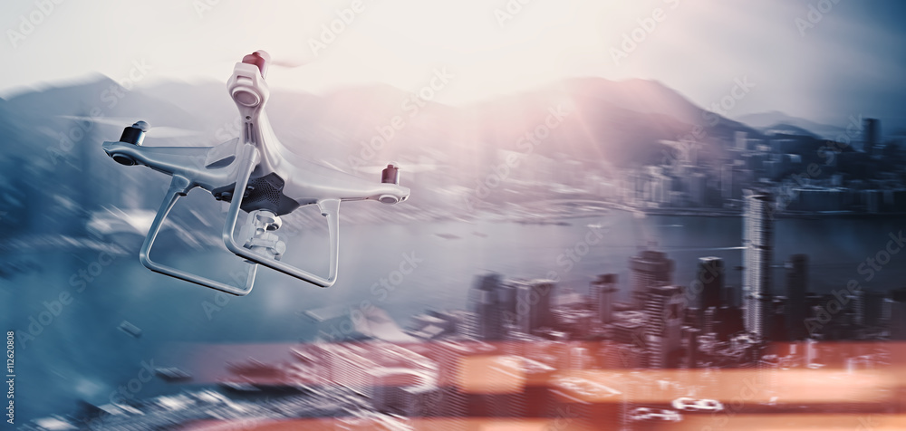 Fototapety, obrazy: Photo White Matte Generic Design Remote Control Air Drone with action camera Flying Sky under City. Modern Megapolis Background. Wide, side view. Motion Blur,Flare Effect. 3D rendering.