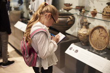 Student Looking At Artifacts I...