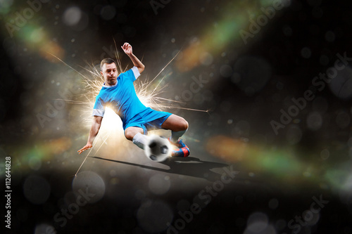 Photo Stands Football soccer player in action