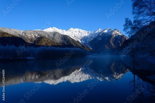 Recess Fitting Night Lake Taisho and Hotaka mountains in winter in Kamikochi, Nagano, Japan
