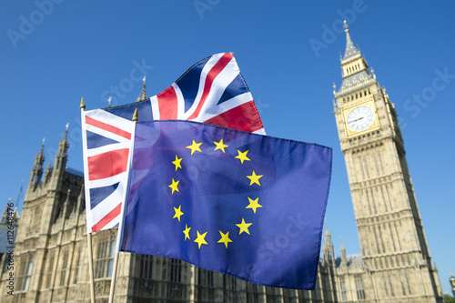 Photo  European Union and British Union Jack flag flying in front of Big Ben and Westmi