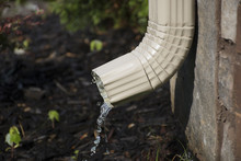 Gutter Downspout With Water - Side View